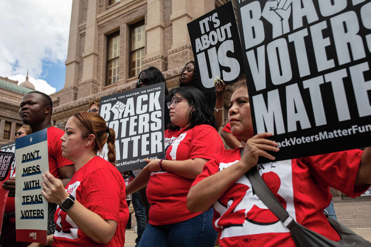 Demonstrators are gathered outside of the Texas State Capitol during a voting rights rally on the first day of the 87th Legislature's special session on July 8, 2021 in Austin, Texas.