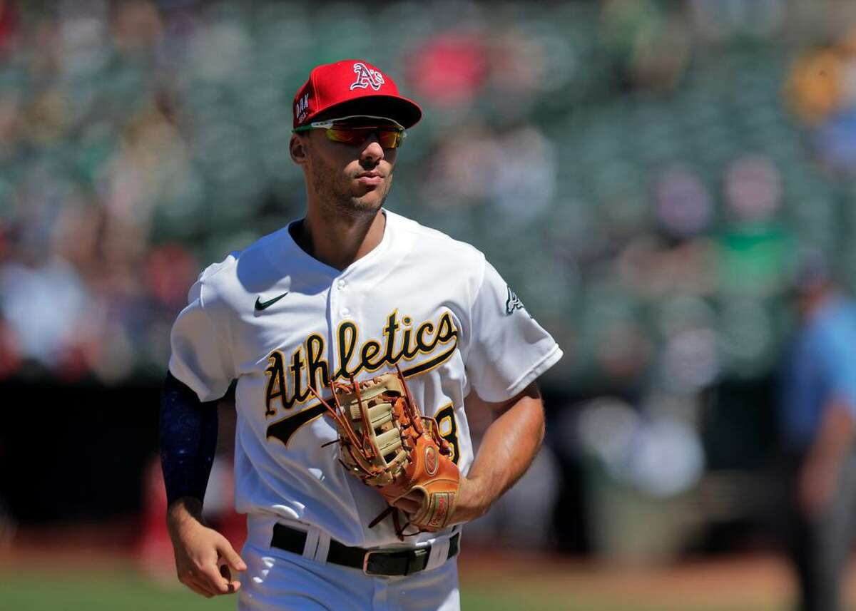 Matt Olson (28) runs back to the dugout in the middle of the ninth as the Oakland Athletics played the Boston Red Sox at the Coliseum in Oakland, Calif., on Sunday, July 4, 2021. The A's were defeated 0-1.