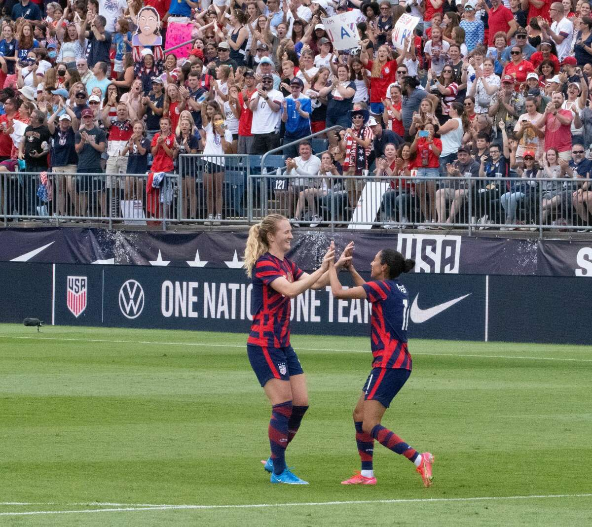 US Women's Soccer National Team members Kristie Mewis and Christen Press celebrate a goal in a Send-Off Series match against Mexico at Pratt & Whitney Stadium in East Hartford, Conn. on Monday, July 5, 2021. The U.S. won 4-0 over Mexico. (Joyce Bassett / Special to the Times Union)