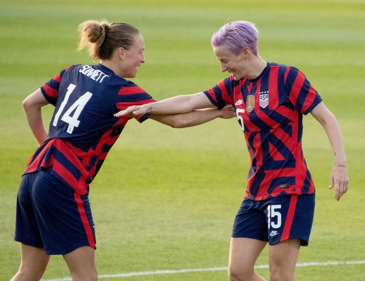 Megan Rapinoe and Emily Sonnett of the US Women's Soccer National Team during a Send-Off ceremony at Pratt & Whitney Stadium in East Hartford, Conn. after a match against Mexico on Monday, July 5, 2021. The U.S. won 4-0 over Mexico. (Joyce Bassett / Special to the Times Union)