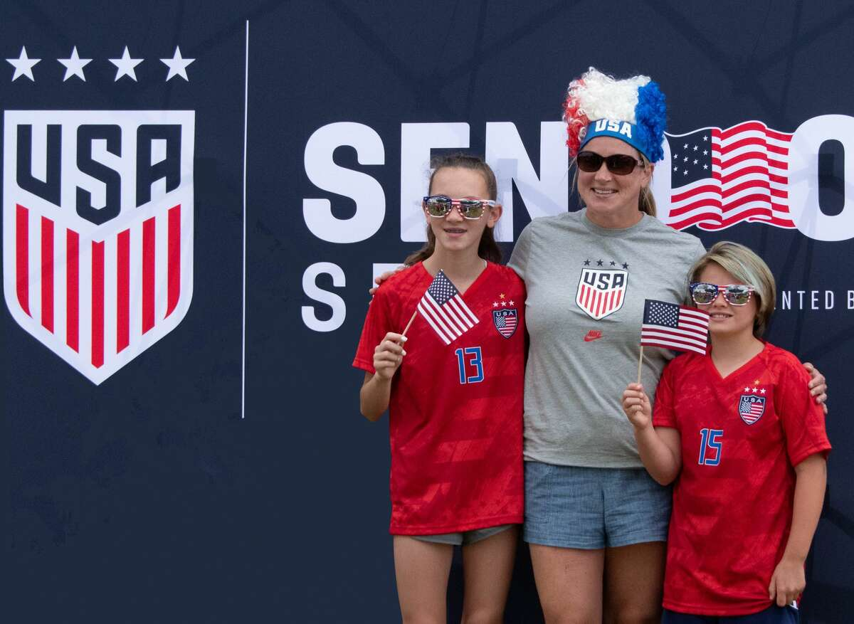 Myah, 12, and Kennedy, 9, with their mom Kiera Hovey of Cohoes at the US Women's Soccer National Team photo booth at Pratt & Whitney Stadium in East Hartford, Conn. during a Send-Off Series match against Mexico on Monday, July 5, 2021. The U.S. won 4-0 over Mexico. (Joyce Bassett / Special to the Times Union)