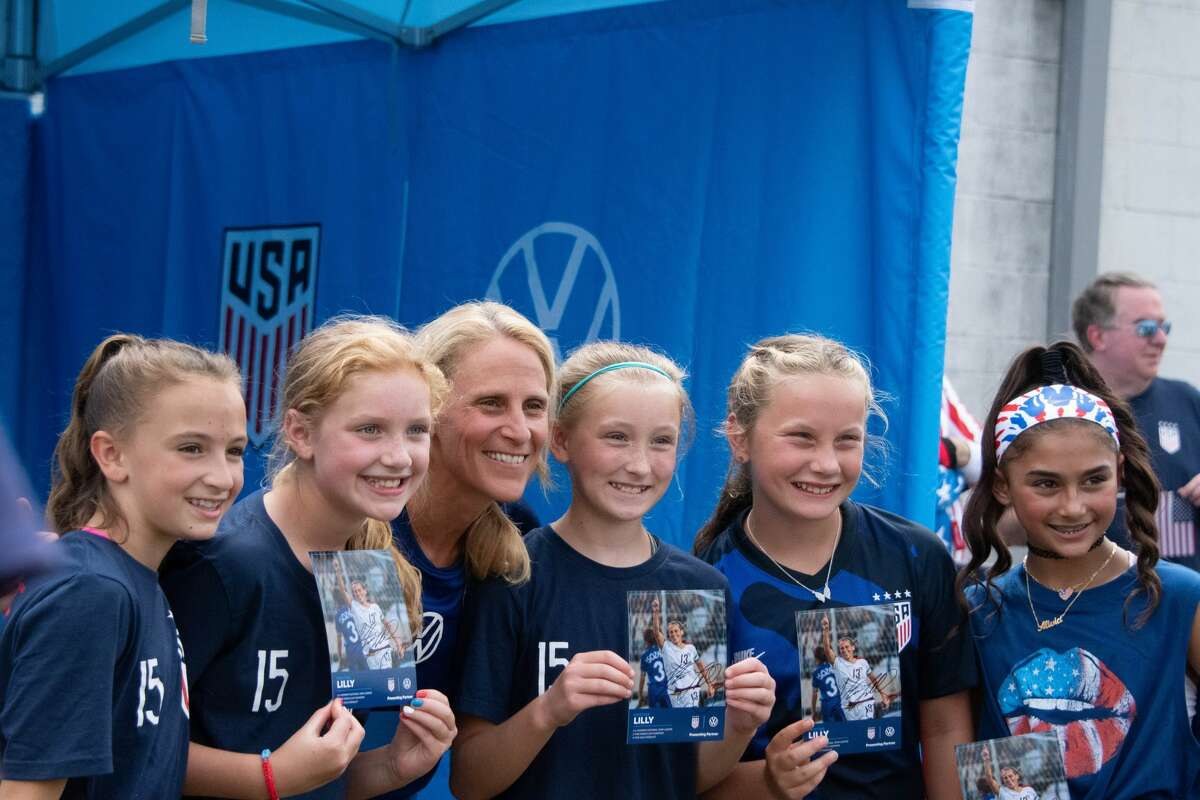 Young fans get autographs from former US Women's National Team star Kristine Lilly before a Send-Off Series match against Mexico at Pratt & Whitney Stadium in East Hartford, Conn. on Monday, July 5, 2021. The U.S. won 4-0 over Mexico. (Joyce Bassett / Special to the Times Union)