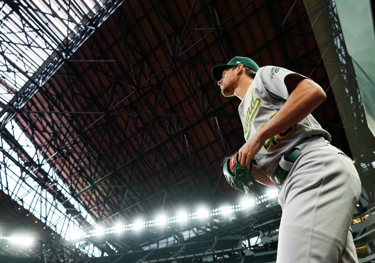 ARLINGTON, TX - JUNE 24: Chris Bassitt #40 of the Oakland Athletics walks to the bullpen prior to the game against the Texas Rangers at Globe Life Field on June 24, 2021 in Arlington, Texas. (Photo by Alex Bierens de Haan/Getty Images)