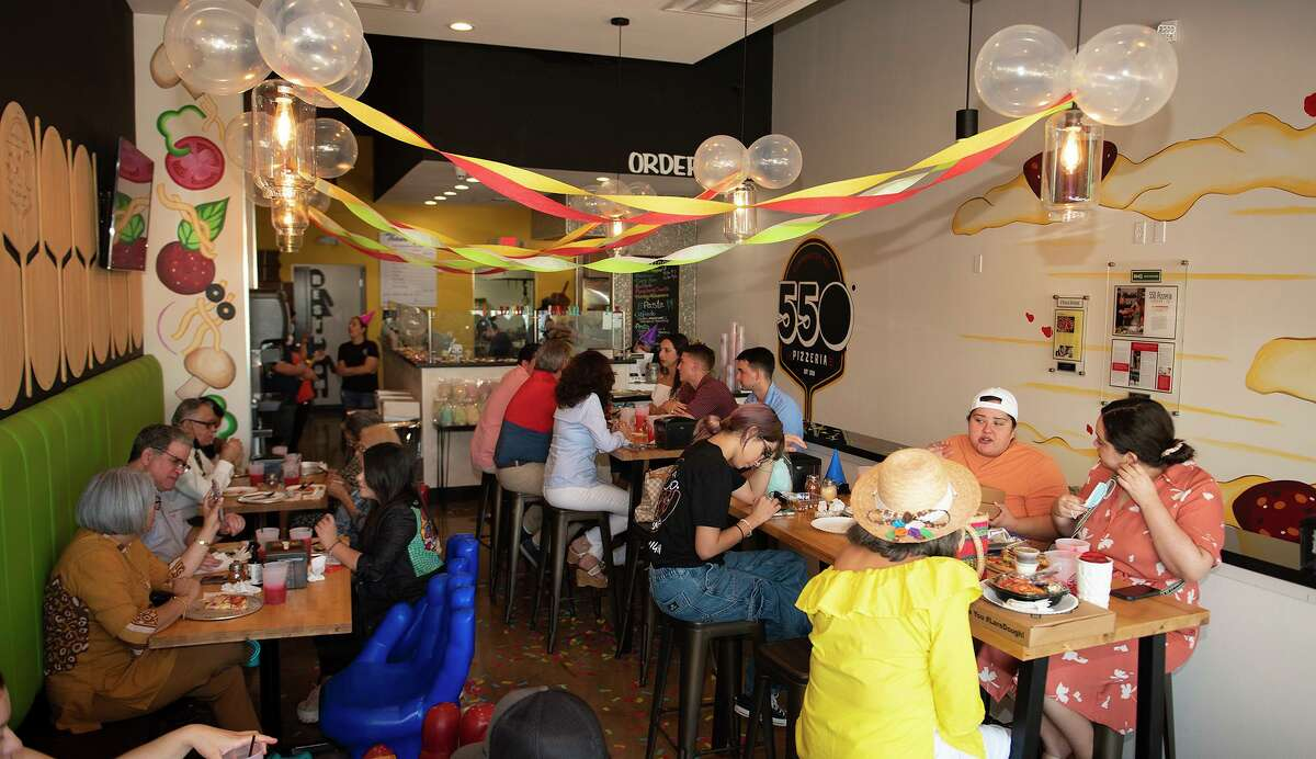 550 Pizzeria customers are pictured at the restaurant's one-year anniversary event, Sunday, June 20, 2021. Businesses all around Laredo have had to adapt due to the water issues that have plagued the city this week.