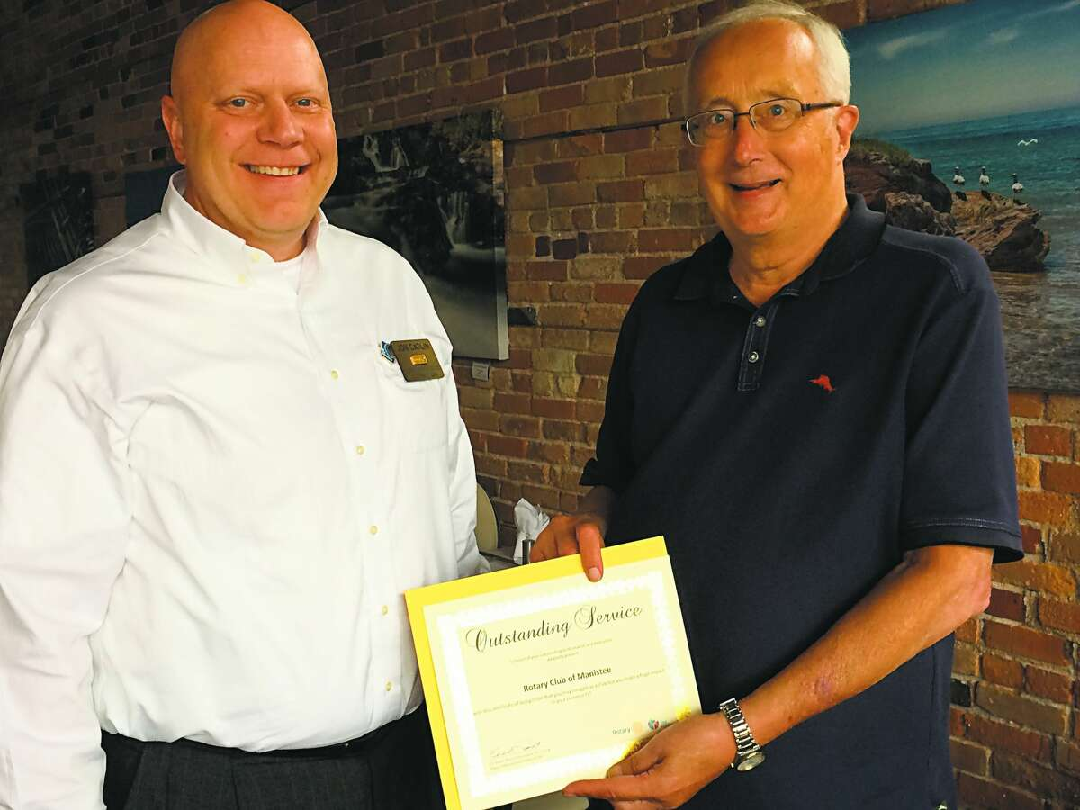 The Manistee Rotary Club was presented with a certificate for Outstanding Service by Rotary District No. 6290 in 2018. Pictured are Jon Catlin, District Treasurer, and Bill Zamrowski, interim club president (at the time). The Rotary Club disbanded in late June after 97 years.