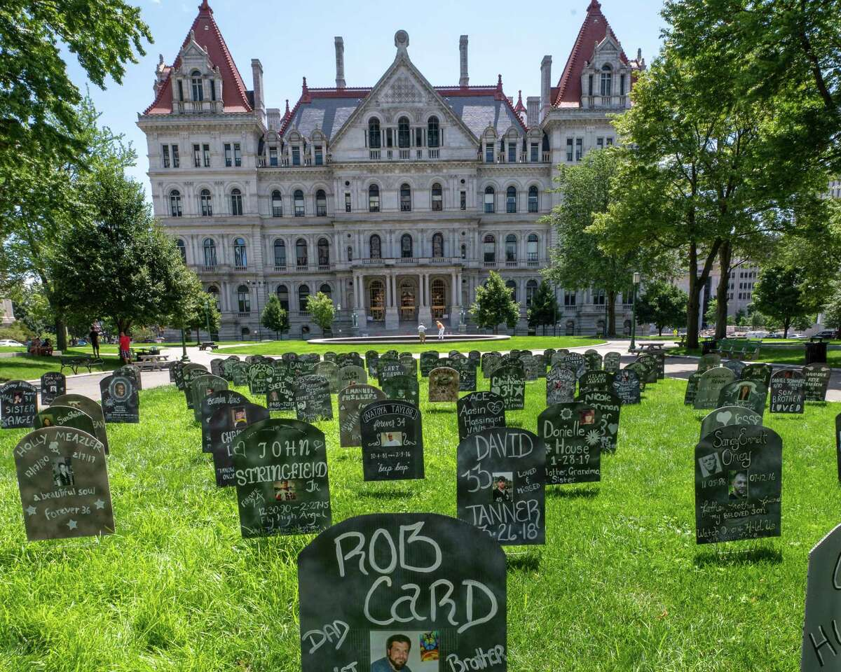 The names of people who died of overdose were written on gravestones during a press conference by No OD NY at West Capitol Park in Albany, NY, on Saturday, July 10, 2021 as part of a month-long campaign to raise awareness of overdose deaths and to call on Gov. Andrew Cuomo and the state Legislature to fund Overdose Prevention Centers. (Jim Franco/Special to the Times Union)