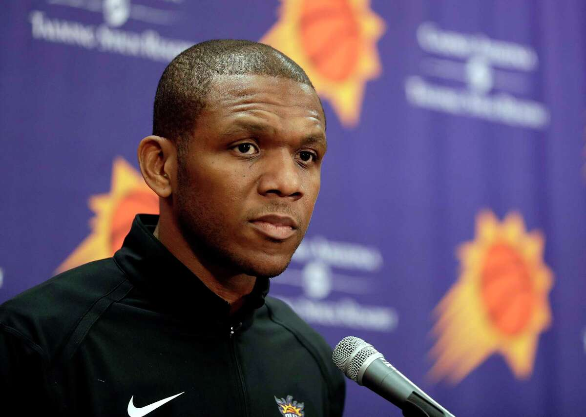 FILE - In this April 24, 2019, file photo, Phoenix Suns general manager James Jones speaks to the media regarding the firing of Suns head coach Igor Kokoskov during an NBA basketball news conference in Phoenix. Jones' hiring of coach Monty Williams and acquiring of All-Star guard Chris Paul are two of the biggest reasons why the Suns are in the second round of the playoffs for the first time since 2010. (AP Photo/Matt York, FIle)