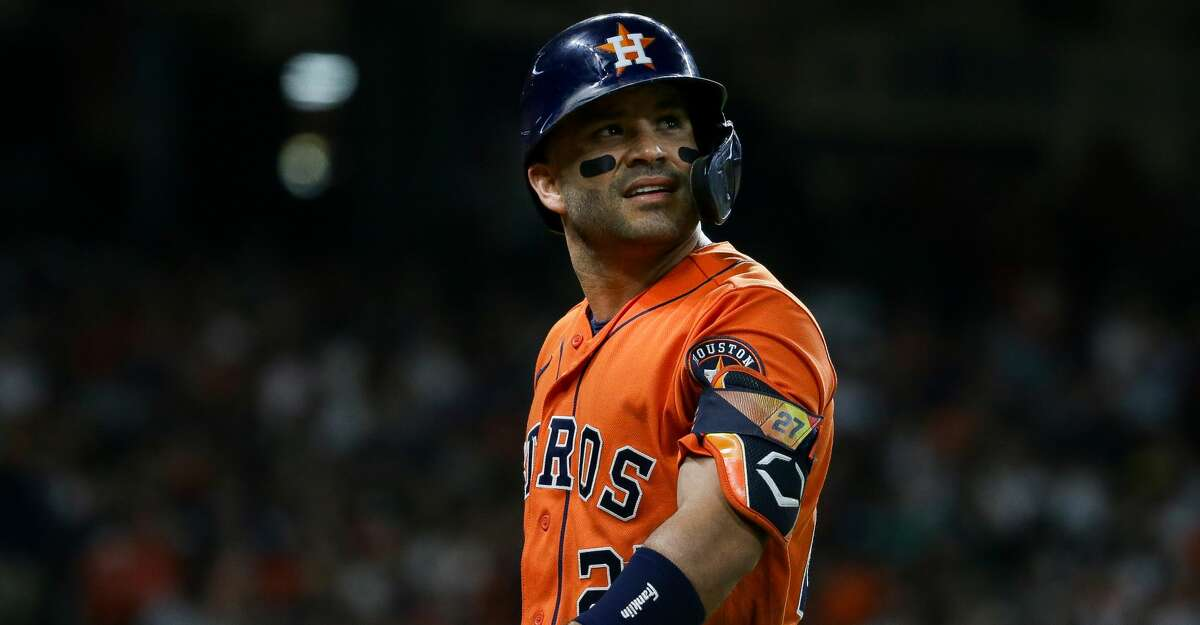 Houston Astros second baseman Jose Altuve (27) walks back to the dugout after hitting a fly out to center field against the New York Yankees during the third inning of an MLB game at Minute Maid Park on Friday, July 9, 2021, in Houston.