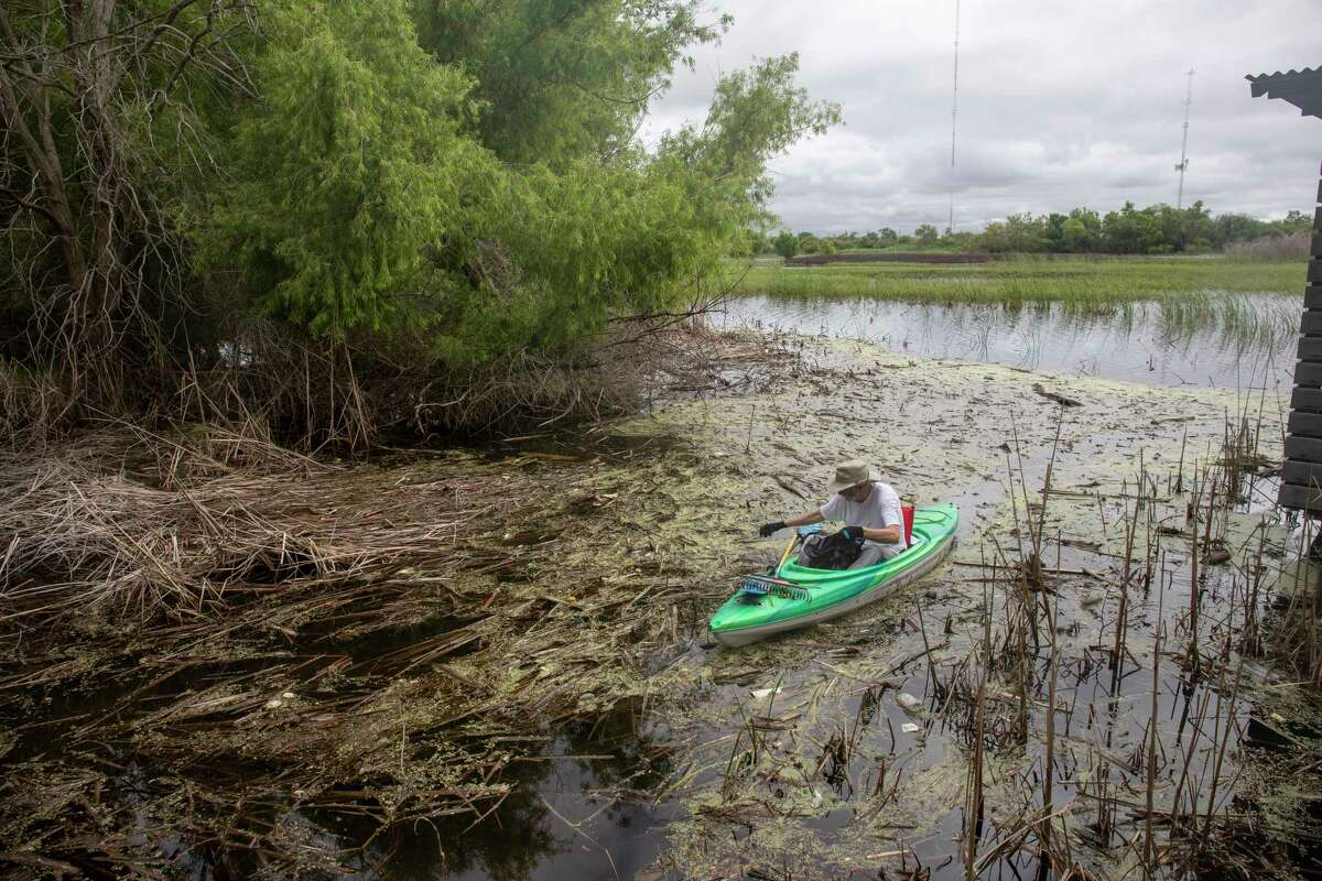Volunteers helped clean debris from the boardwalks and trails Saturday, July 10, 2021 at I-20 Wildlife Preserve. Visitors are not allowed to kayak in the playa lake, but volunteer Bill Sower kayaked to retrieve trash that had gotten swept into the lake. Jacy Lewis/Reporter-Telegram