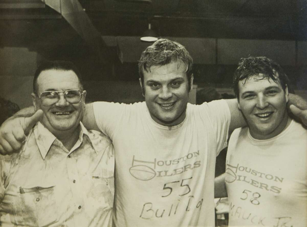 """Former Houston Oilers head coach O.A. """"Bum"""" Phillips is shown in a photo with former Oilers players Carl Mauck, center, and David Carter that hangs on the wall of his office copied Tuesday, Sept. 21, 2010, in Goliad. ( Phillips Family Photo )"""