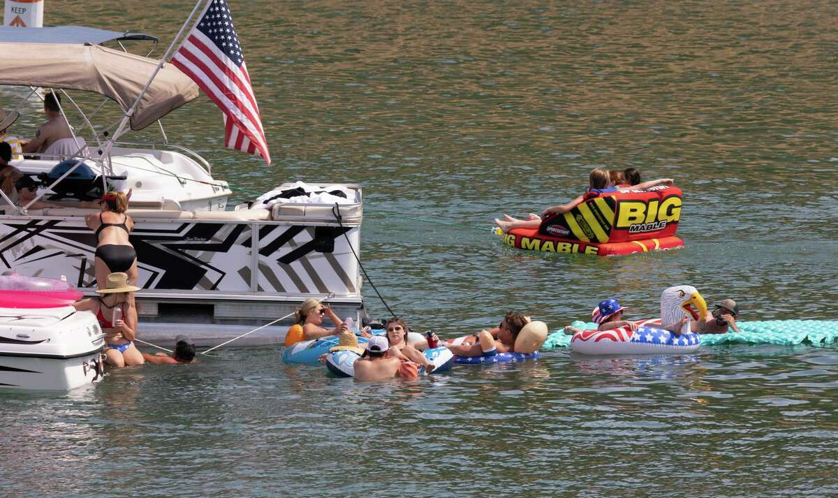Boaters at Pope Creek enjoy the Fourth of July holiday weekend at Lake Berryessa in Napa County. The heat continued at the lake on Saturday, with temperatures hitting 112 degrees shortly after 4 p.m.