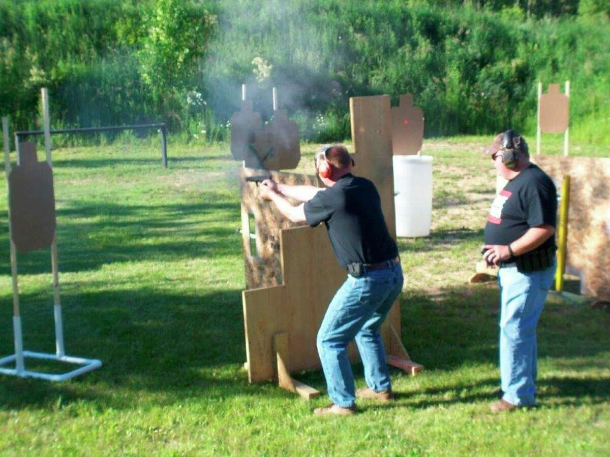 """Competitive """"action"""" pistol shooting is often a timed event, as was thecase with the competition pictured here. (Tom Lounsbury/Hearst Michigan)"""