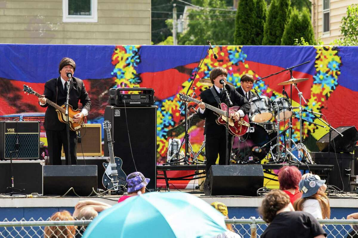Beatles tribute band Britains Best NJ performs during the Fab 4 Music Festival at Nolan Field in Ansonia on Saturday, July 10 2021.