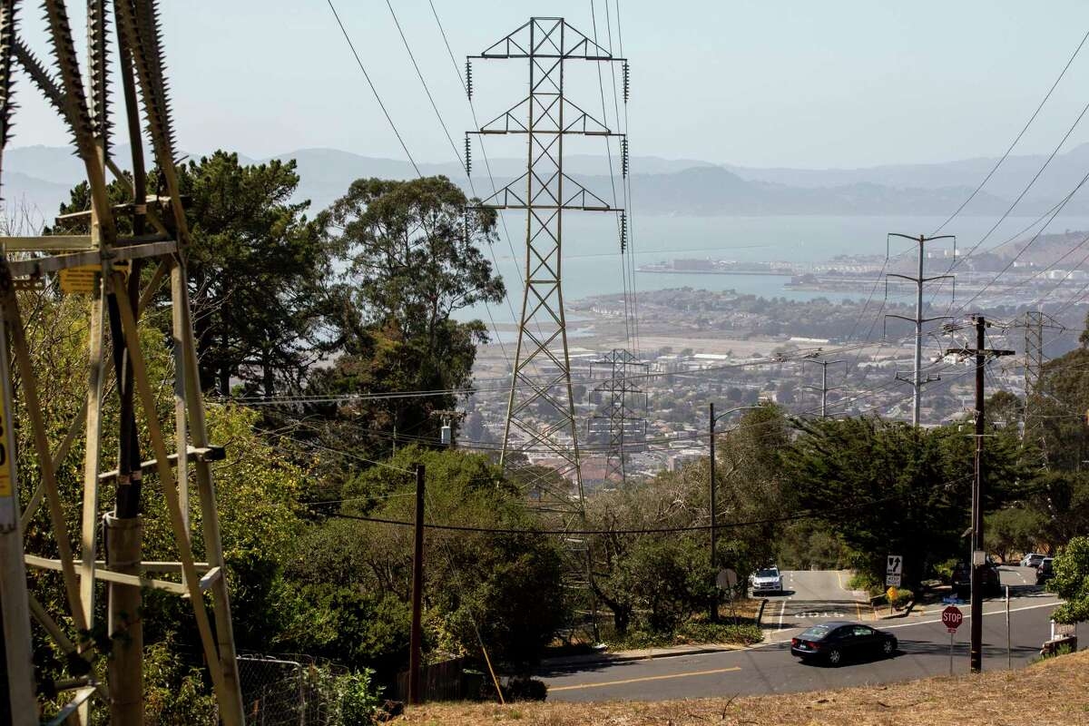 This file photograph shows high voltage power lines sit over homes seen from Terrace Drive in El Cerrito, Calif. Friday, September 25, 2020.