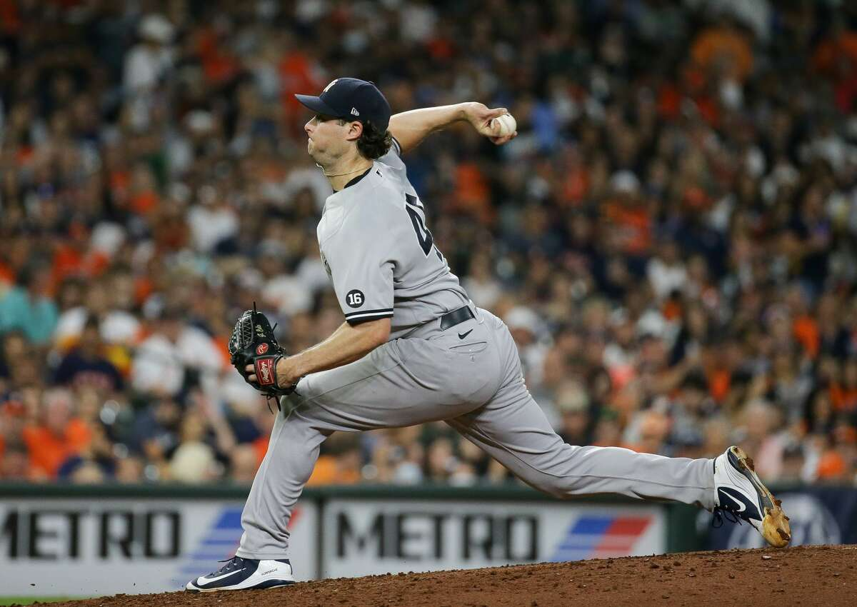 New York Yankees starting pitcher Gerrit Cole (45) throws against the Houston Astros during the seventh inning of an MLB game at Minute Maid Park on Saturday, July 10, 2021, in Houston.