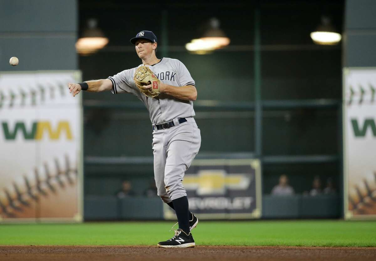 New York Yankees first baseman DJ LeMahieu (26) throws to first base for an out against the Houston Astros during the fifth inning of an MLB game at Minute Maid Park on Saturday, July 10, 2021, in Houston.