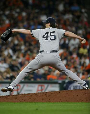 New York Yankees starting pitcher Gerrit Cole (45) throw against the Houston Astros during the sixth inning of an MLB game at Minute Maid Park on Saturday, July 10, 2021, in Houston. Photo: Godofredo A Vásquez/Staff Photographer / © 2021 Houston Chronicle