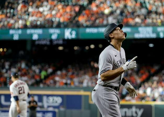 New York Yankees right fielder Aaron Judge (99) points to the sky as he approaches home plate after hitting a solo home run against Houston Astros starting pitcher Zack Greinke (21) during the third inning of an MLB game at Minute Maid Park on Saturday, July 10, 2021, in Houston. Photo: Godofredo A Vásquez/Staff Photographer / © 2021 Houston Chronicle