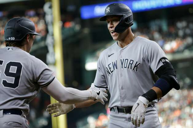 New York Yankees right fielder Aaron Judge (99) celebrates with first baseman Luke Voit (59) after hitting a solo home run against Houston Astros starting pitcher Zack Greinke (21) during the third inning of an MLB game at Minute Maid Park on Saturday, July 10, 2021, in Houston. Photo: Godofredo A Vásquez/Staff Photographer / © 2021 Houston Chronicle