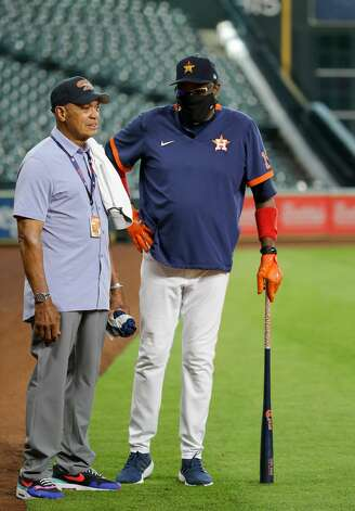 Houston Astros manager Dusty Baker Jr. (12) talks with hall of famer Reggie Jackson before an MLB game against the New York Yankees at Minute Maid Park on Saturday, July 10, 2021, in Houston. Photo: Godofredo A Vásquez/Staff Photographer / © 2021 Houston Chronicle