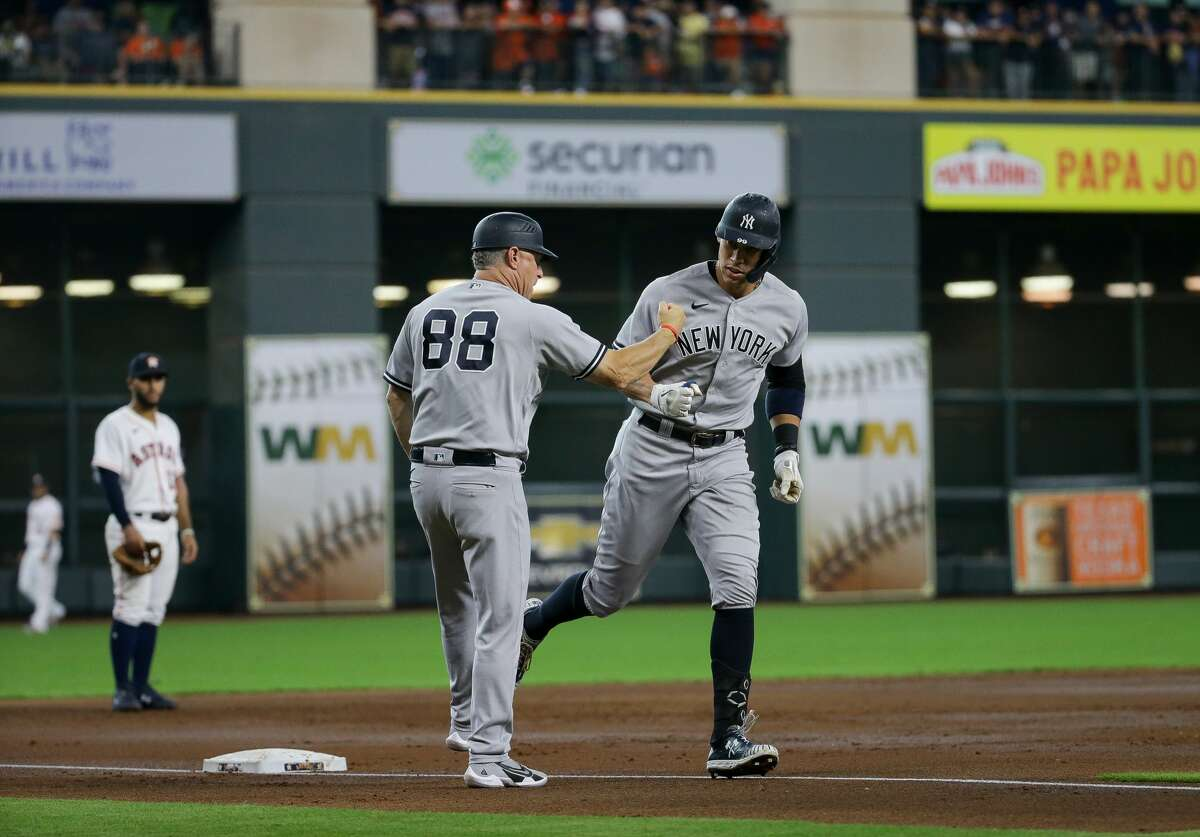 New York Yankees right fielder Aaron Judge (99) rounds the bases after hitting a solo home run against Houston Astros starting pitcher Zack Greinke (21) during the first inning of an MLB game at Minute Maid Park on Saturday, July 10, 2021, in Houston.