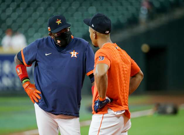Houston Astros manager Dusty Baker Jr. (12) talks with shortstop Robel Garcia (9) during batting practice, before an MLB game against the New York Yankees at Minute Maid Park on Saturday, July 10, 2021, in Houston. Photo: Godofredo A Vásquez/Staff Photographer / © 2021 Houston Chronicle