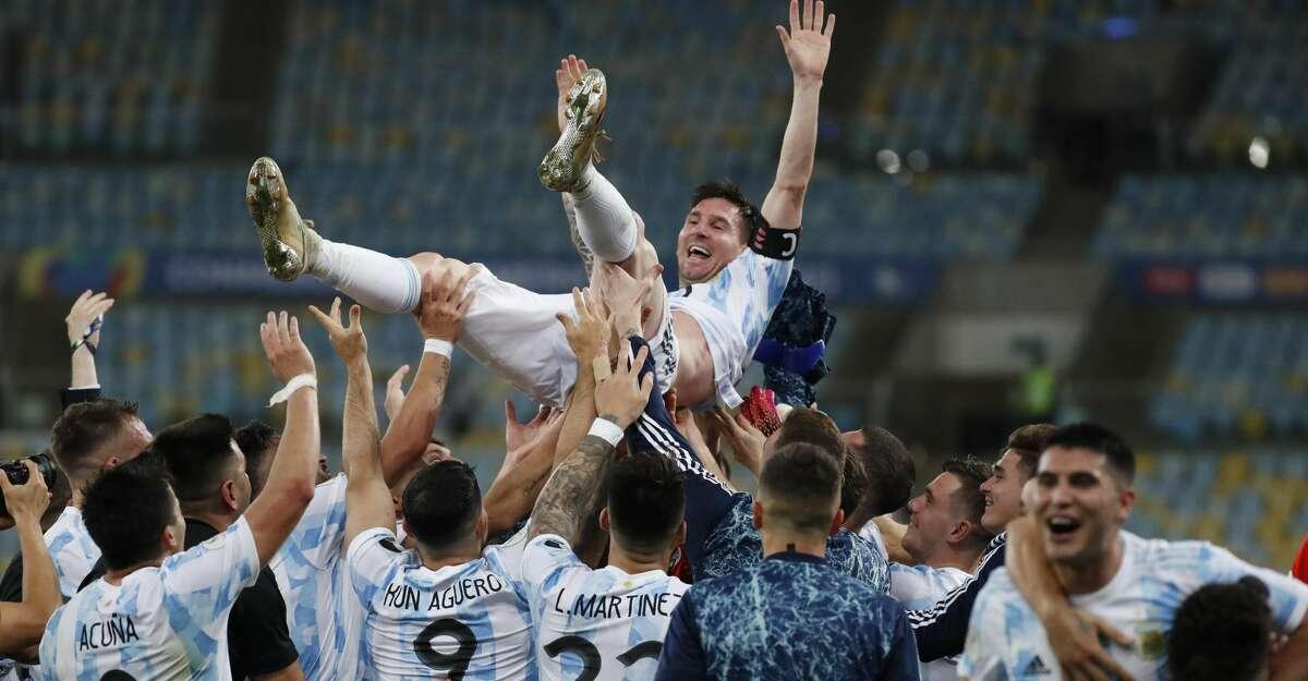 Teammates lift Argentina's Lionel Messi after beating Brazil 1-0 during the Copa America final soccer match at the Maracana stadium in Rio de Janeiro, Brazil, Saturday, July 10, 2021. (AP Photo/Bruna Prado)