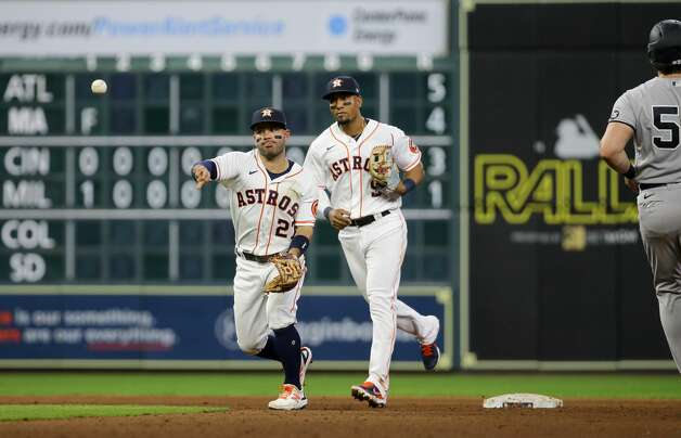 Houston Astros second baseman Jose Altuve (27) turns a double play against the New York Yankees during the eighth inning of an MLB game at Minute Maid Park on Saturday, July 10, 2021, in Houston. Photo: Godofredo A Vásquez/Staff Photographer / © 2021 Houston Chronicle