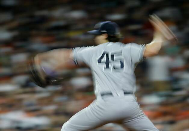 New York Yankees starting pitcher Gerrit Cole (45) throws against the Houston Astros during the eighth inning of an MLB game at Minute Maid Park on Saturday, July 10, 2021, in Houston. Photo: Godofredo A Vásquez/Staff Photographer / © 2021 Houston Chronicle