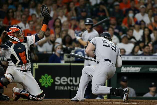 New York Yankees first baseman Luke Voit (59) avoids being hit by a pitch during the eighth inning of an MLB game against the Houston Astros at Minute Maid Park on Saturday, July 10, 2021, in Houston. Photo: Godofredo A Vásquez/Staff Photographer / © 2021 Houston Chronicle