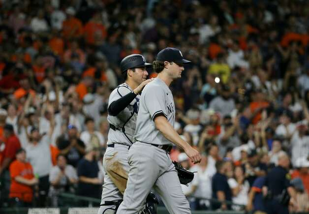 New York Yankees starting pitcher Gerrit Cole (45) celebrates with catcher Kyle Higashioka (66) after throwing a complete game shutout against the Houston Astros at Minute Maid Park on Saturday, July 10, 2021, in Houston. Photo: Godofredo A Vásquez/Staff Photographer / © 2021 Houston Chronicle