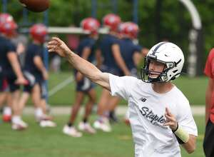 Staples' quarterback Ryan Thompson throws a pass during Day 2 of the Grip It and Rip It football tournament in New Canaan on Saturday, July 10, 2021.