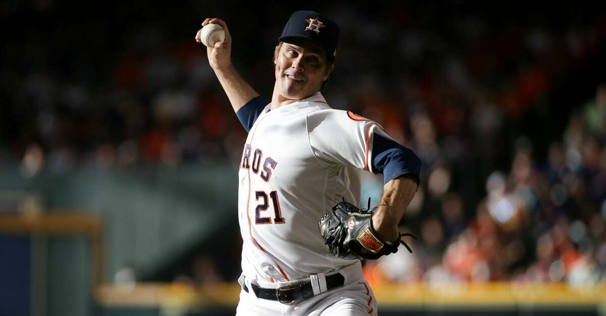 Houston Astros starting pitcher Zack Greinke (21) throws against the New York Yankees during the second inning of an MLB game at Minute Maid Park on Saturday, July 10, 2021, in Houston.