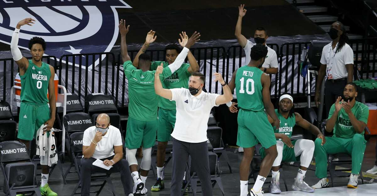 The Nigeria bench reacts after Ike Iroegbu #1 of Nigeria hit a 3-pointer against the United States in the fourth quarter of an exhibition game at Michelob ULTRA Arena ahead of the Tokyo Olympic Games on July 10, 2021 in Las Vegas, Nevada. Nigeria defeated the United States 90-87. (Photo by Ethan Miller/Getty Images)
