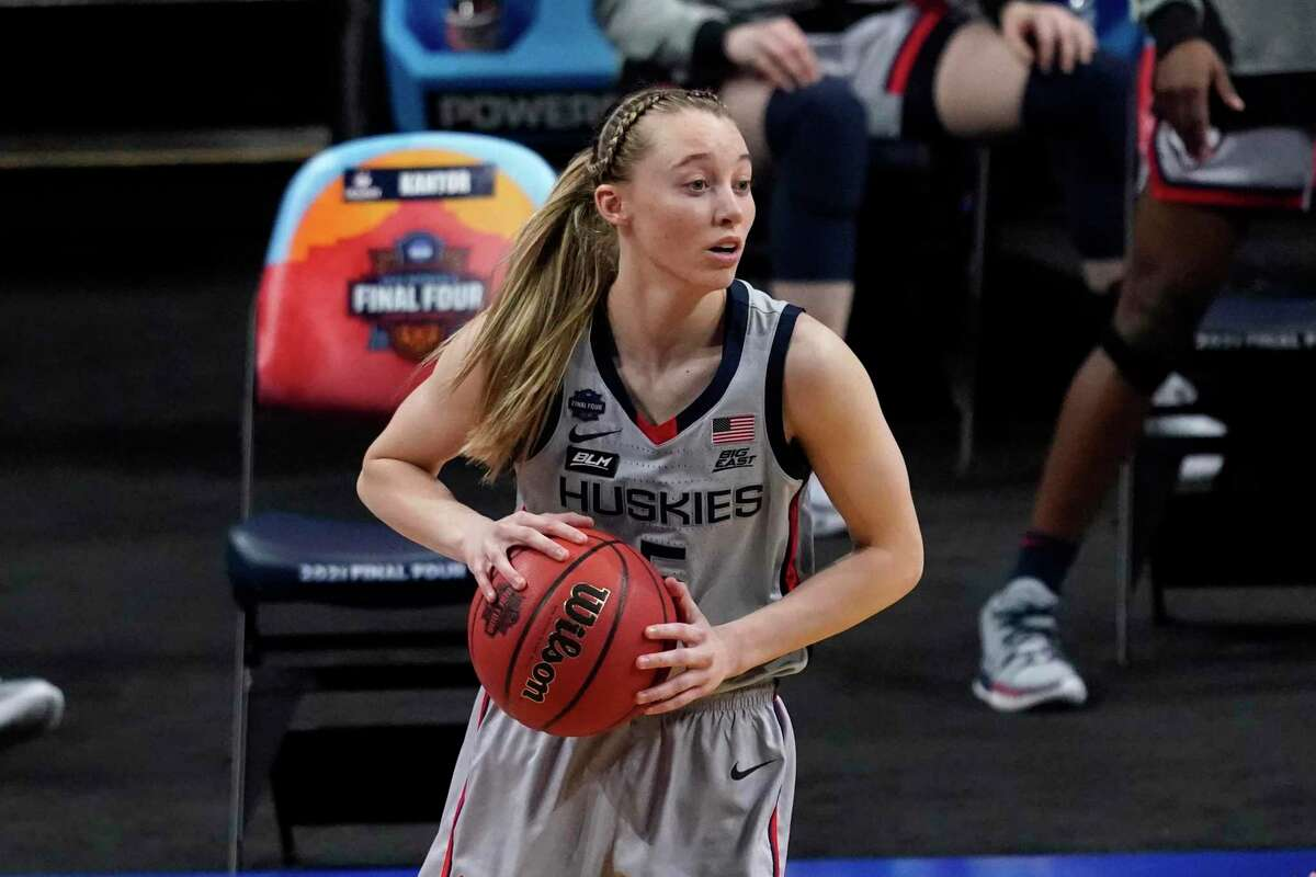 Connecticut guard Paige Bueckers (5) looks to pass up court during the first half of a women's Final Four NCAA college basketball tournament semifinal game against Arizona Friday, April 2, 2021, at the Alamodome in San Antonio. (AP Photo/Eric Gay)