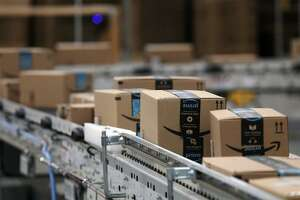 Packages passed down a conveyor belt before receiving a shipping label at Amazon in Shakopee, Minn. (Anthony Souffle/Minneapolis Star Tribune/TNS)