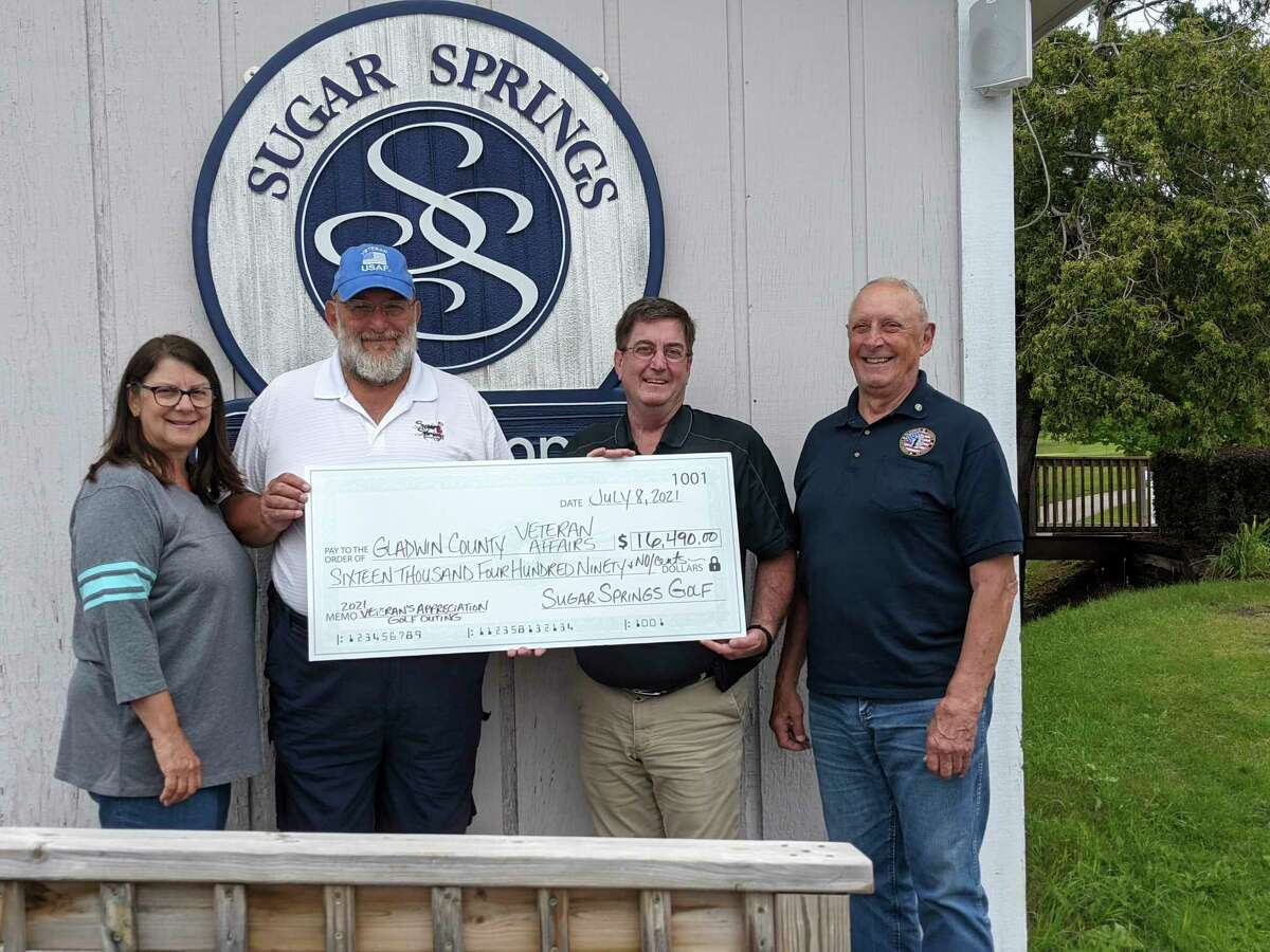 From left, Sherri Visnaw, Mike Visnaw, Gladwin county Veterans Affairs Director Ken Roberts and Gladwin Fire Chief George Alward, at the Sugar Springs Golf Club Thursday, where Mike Visnaw presented the check to Roberts. In all, the June 14 veterans Golf outing fundraiser earned $17,500. The check is for the large portion.(Photo by Tereasa Nims/for the Midland Daily News)