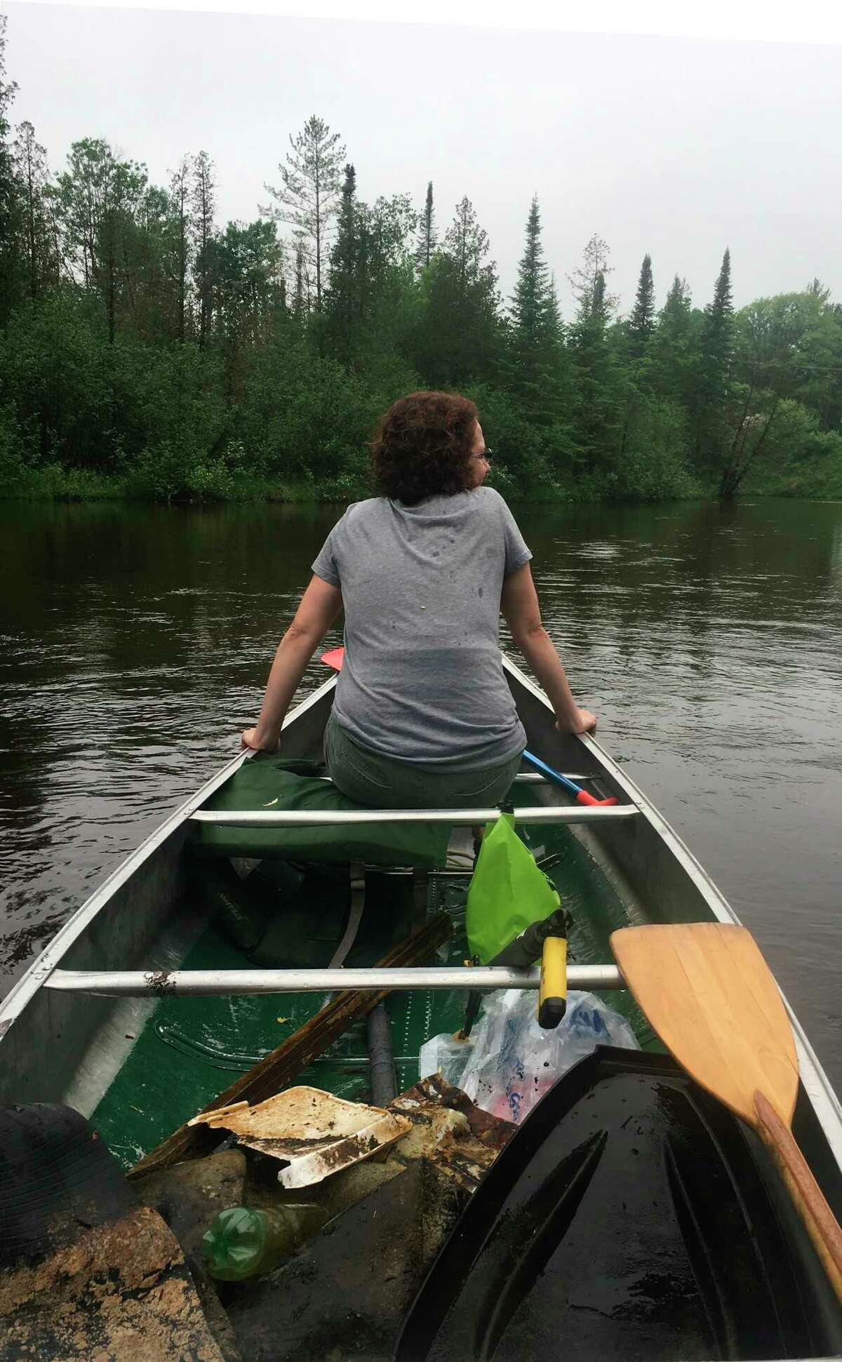 Annie Browning, river steward, cruises the Platte River for trash during a past event. (Courtesy Photo)