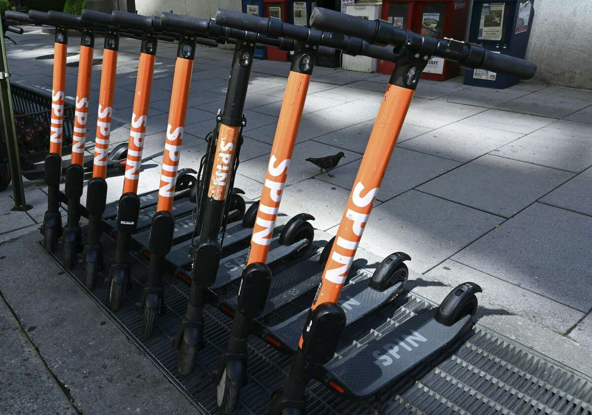 Shared ride Spin electric scooters are lined up on a street in Washington, DC June 11, 2019. (Photo by EVA HAMBACH / AFP) (Photo credit should read EVA HAMBACH/AFP via Getty Images)