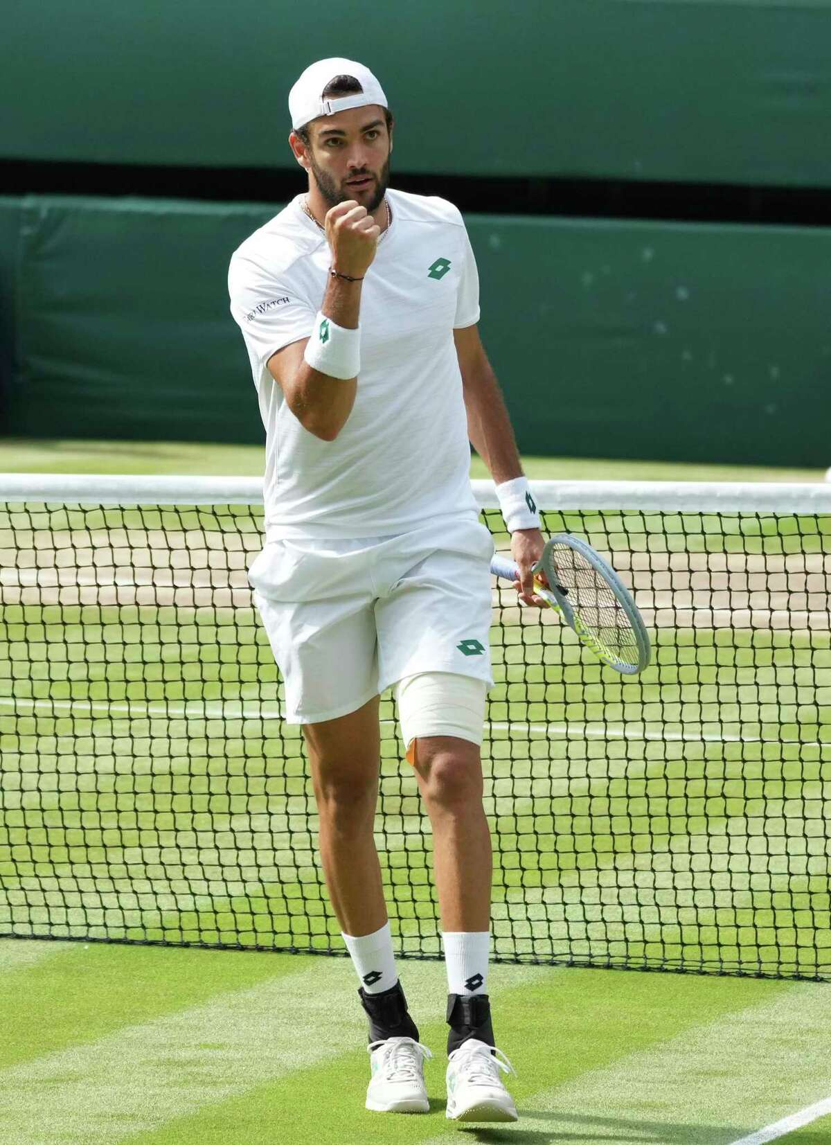 Italy's Matteo Berrettini celebrates winning a point against Serbia's Novak Djokovic during the men's singles final match on day thirteen of the Wimbledon Tennis Championships in London, Sunday, July 11, 2021.