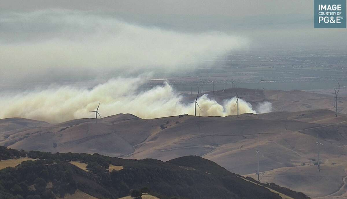 A brush fire started July 11, 2021 near Byron, Calif.