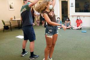 """Josh Winston and Jordyn Libow, both 17, playing the roles of Jamie and Cathy in """"The Last Five Years,"""" rehearse choreography at River House in the Cos Cob section of Greenwich, Conn. Sunday, July 11, 2021. Unlike many of the arts organizations in town, Greenwich Arts Alliance never closed during the COVID-19 pandemic. The nonprofit, which uses therapeutic arts programs to educate students and seniors, began rehearsal in person again during the first week in June and plans to host two upcoming shows in mid-and-late July."""