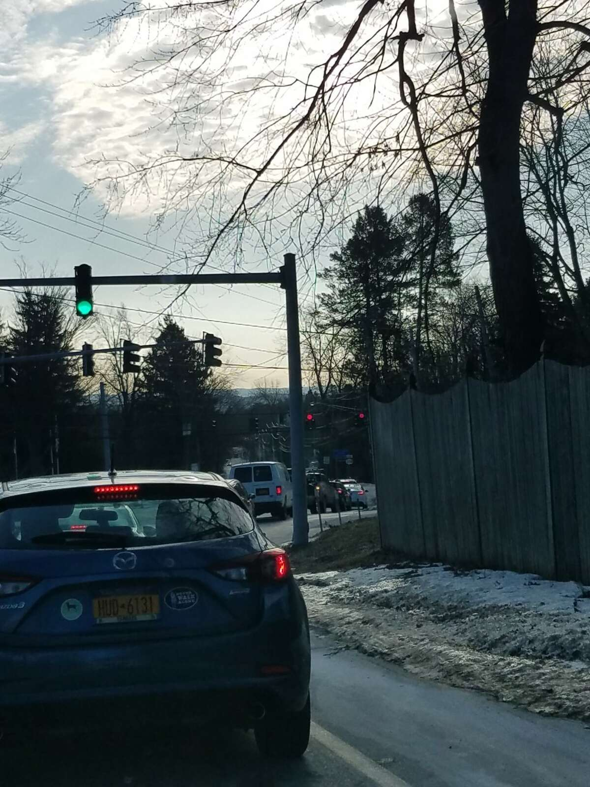 The light is green at Osborne Road, but cars can't move through because the light is red at Route 9, causing cars to back up through the intersection.