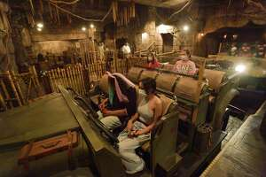 Socially distanced riders also have plastic divider between them on the Indiana Jones Adventure ride at Disneyland in Anaheim on Friday, April 30, 2021.