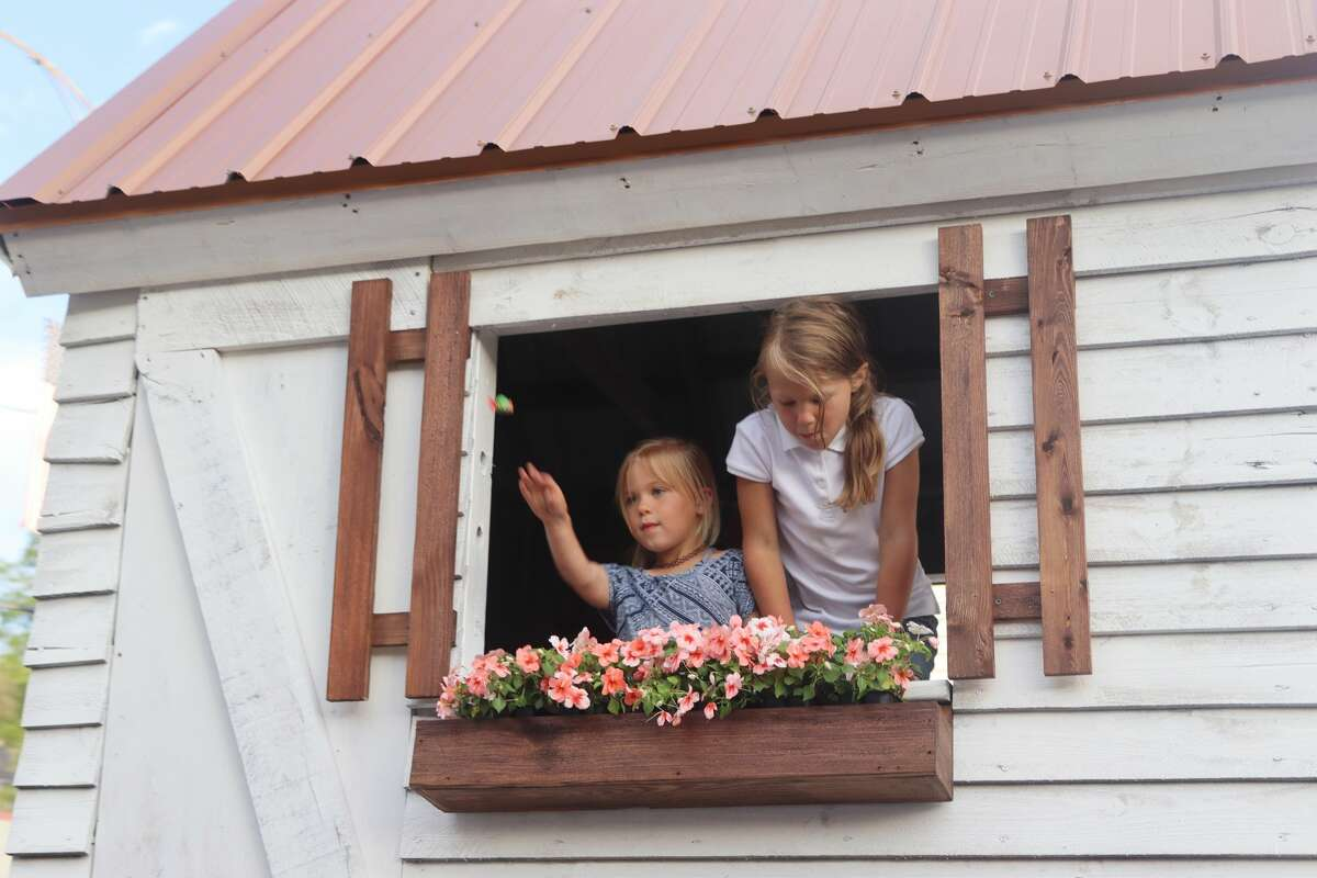 The two girls aboard the Legacy Building Group float were among the parade's stars Saturday.