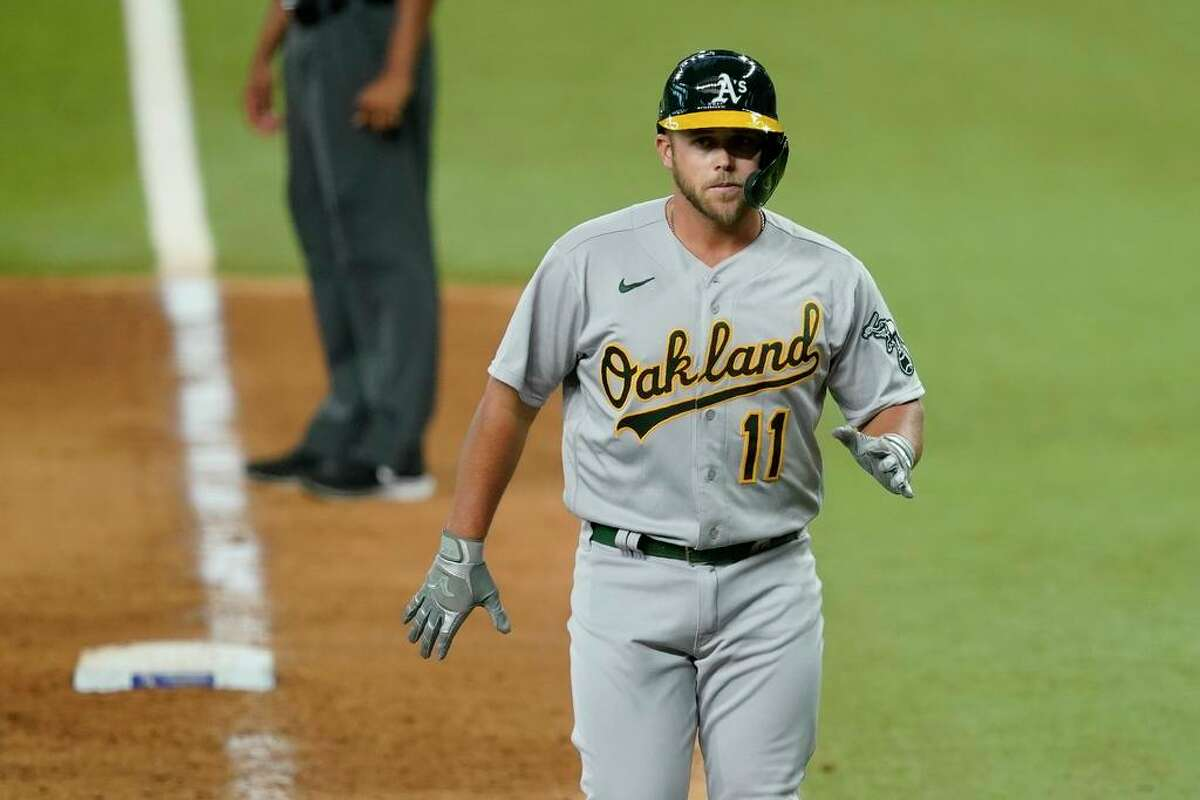 Oakland Athletics' Jacob Wilson heads back to the dugout after popping out to second in the 10th inning of a baseball game against the Texas Rangers in Arlington, Texas, Saturday, July 10, 2021. Wilson made his major league debut with the pinch-hit appearance. (AP Photo/Tony Gutierrez)