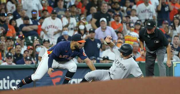 Houston Astros third baseman Abraham Toro (13) tags out New York Yankees second baseman DJ LeMahieu (26) on on runner's fielder's choice during the first inning of the MLB game Sunday, July 11, 2021, from Minute Maid Park in Houston. Photo: Yi-Chin Lee, Staff Photographer / © 2021 Houston Chronicle