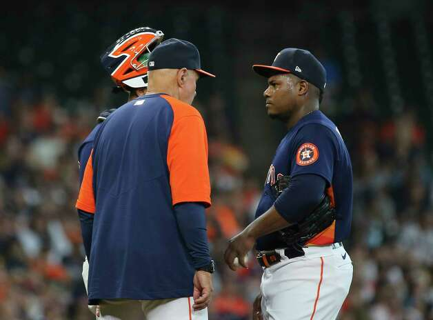 Houston Astros pitching coach Brent Strom (56) visits starting pitcher Framber Valdez (59) during the first inning of the MLB game against the New York Yankees Sunday, July 11, 2021, from Minute Maid Park in Houston. Photo: Yi-Chin Lee, Staff Photographer / © 2021 Houston Chronicle