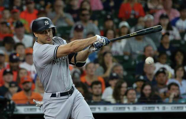 New York Yankees designated hitter Giancarlo Stanton (27) singles to the right during the first inning of the MLB game against the Houston Astros Sunday, July 11, 2021, from Minute Maid Park in Houston. Photo: Yi-Chin Lee, Staff Photographer / © 2021 Houston Chronicle