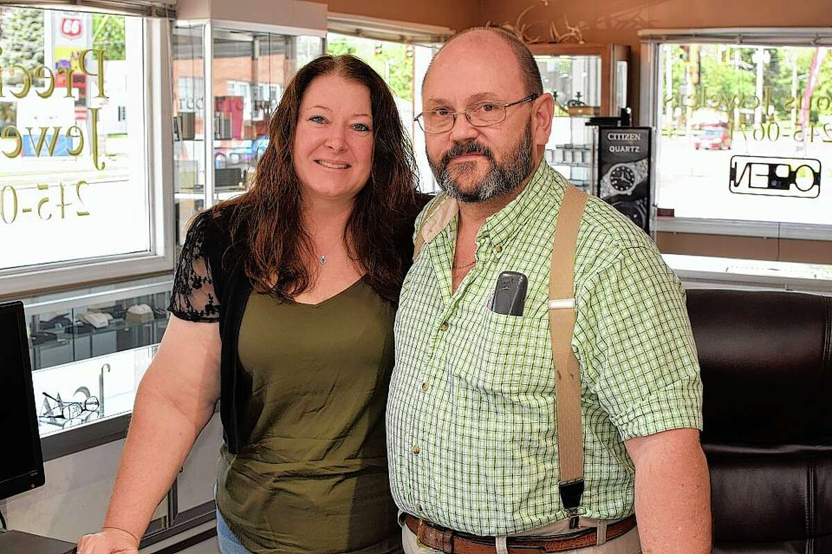 Carolyn and Kevin Denney inside Precious Jewelers, the business they own and operate in South Jacksonville.
